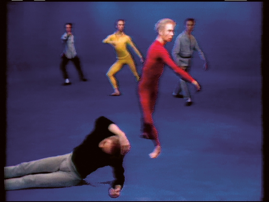A grainy VHS still of five men in dancer-ly positions.
