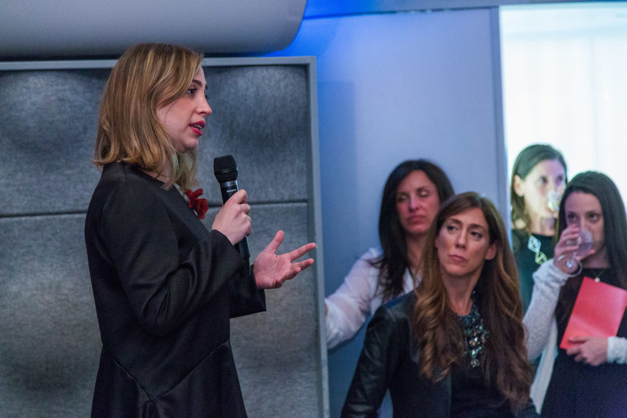 Ayah Bdeir speaking to a crowd at an Eyebeam benefit award ceremony.