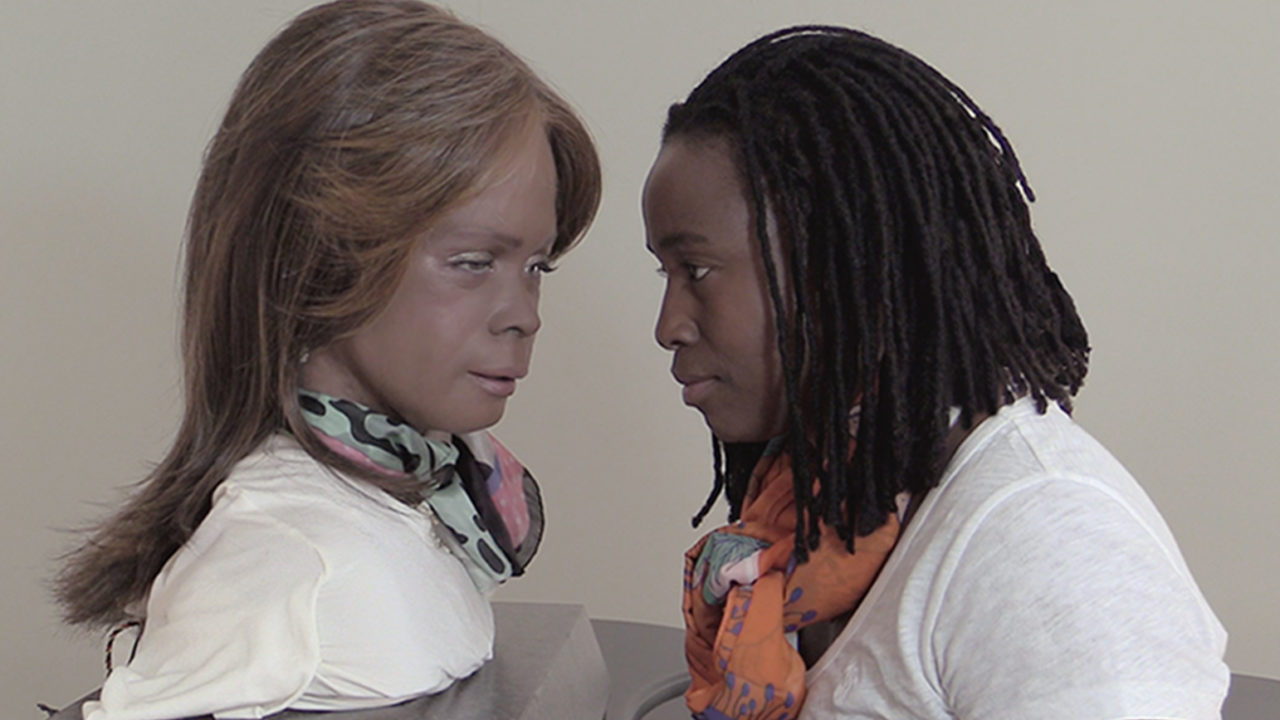 Dinkins looking intently at Bina48, the world's most emotionally intelligent robot.