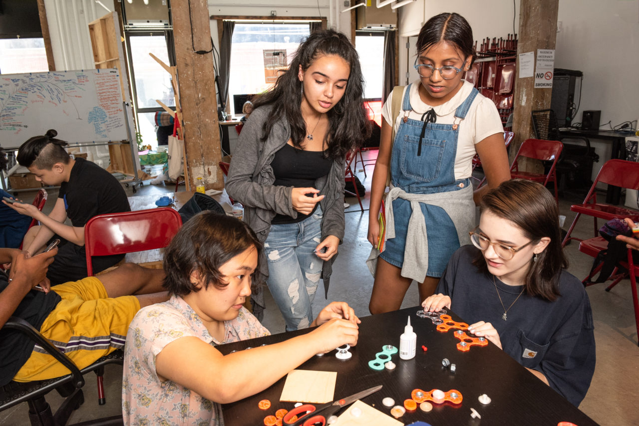 2017 DDC coordinator, Taehee Whang, helping last year's cohort make fidget spinners at Eyebeam's studio..