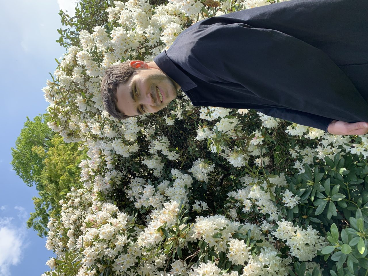 The picture is a portrait of myself made by my partner Ellen Lapper. I'm standing in front of a beautiful blossomed tree and I'm facing the camera.
