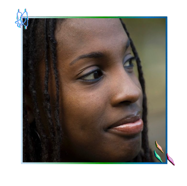 A young woman smiles contently, gazing into the distance to her left. She has dark brown skin and thin black locs framing either side of her face.