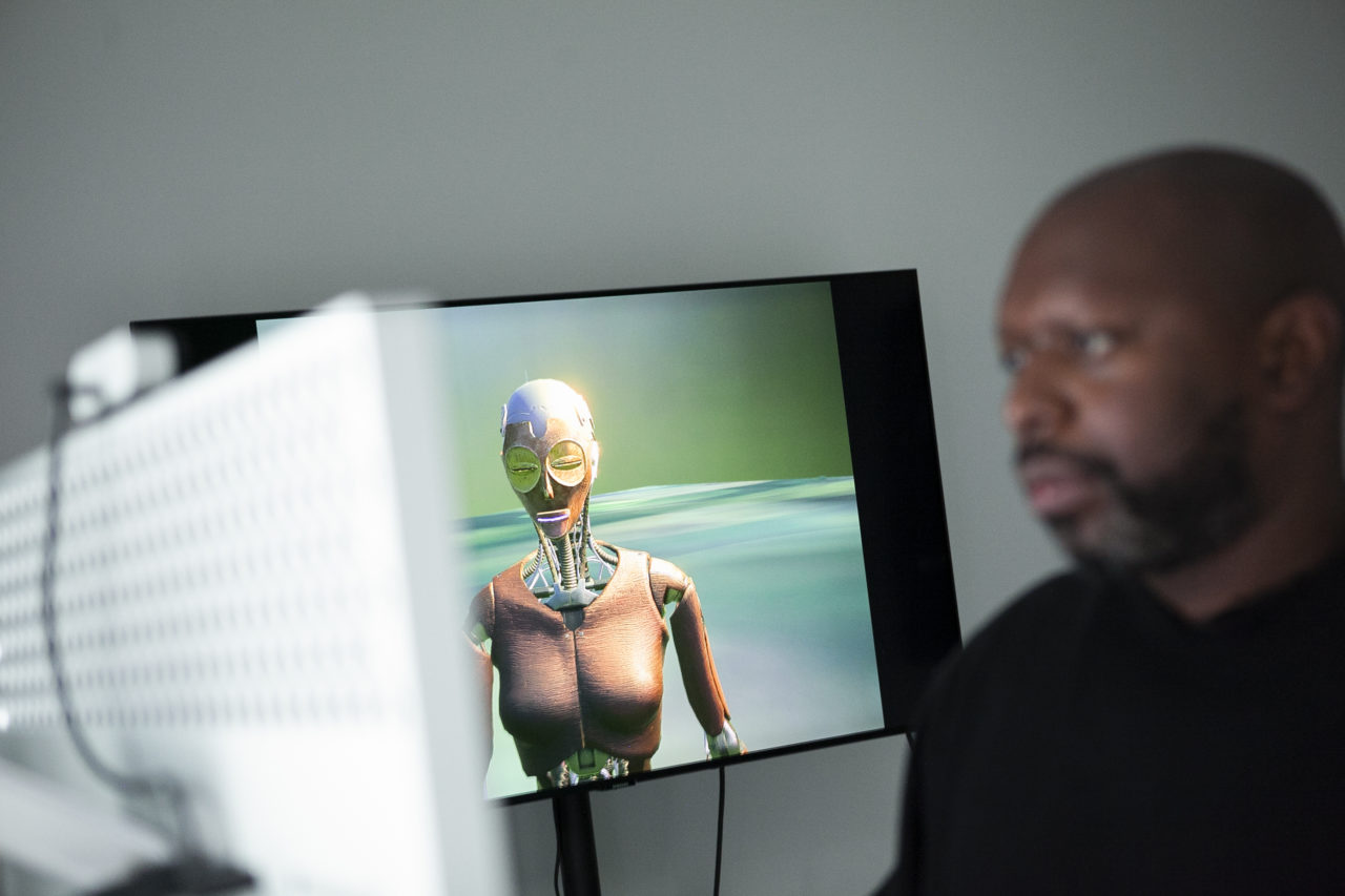 Rashaad Newsome, a Black Man, working in his studio on the AI for Black Mental Health Healing, Being 1.5