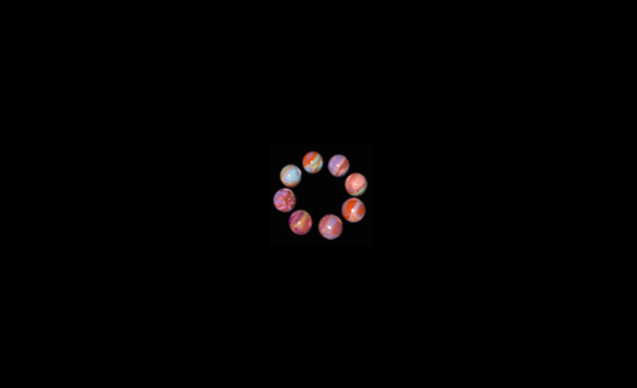 Black screen with 8 orbs that look like marbles of jawbreakers forming a circle