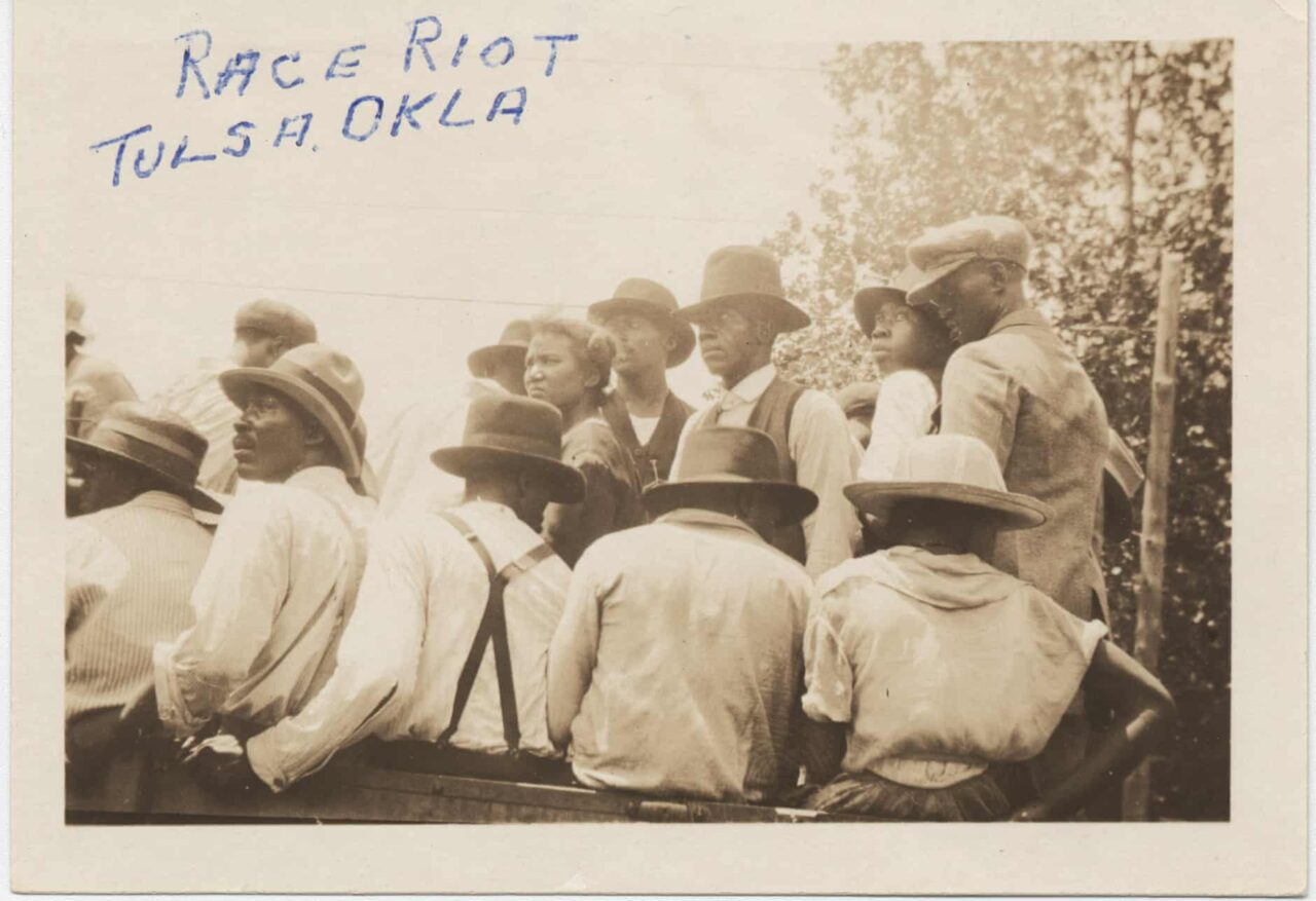 A photo from the Tulsa Race Riot of a group on Black men.