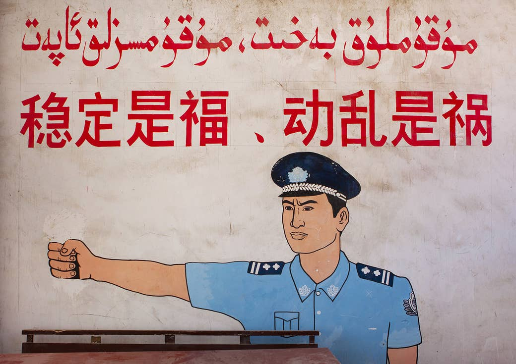 """A wall painting reads """"Stability is a blessing, instability is a calamity,"""" in Yarkand, Xinjiang Uyghur Autonomous Region, China, on Sept. 20, 2012."""